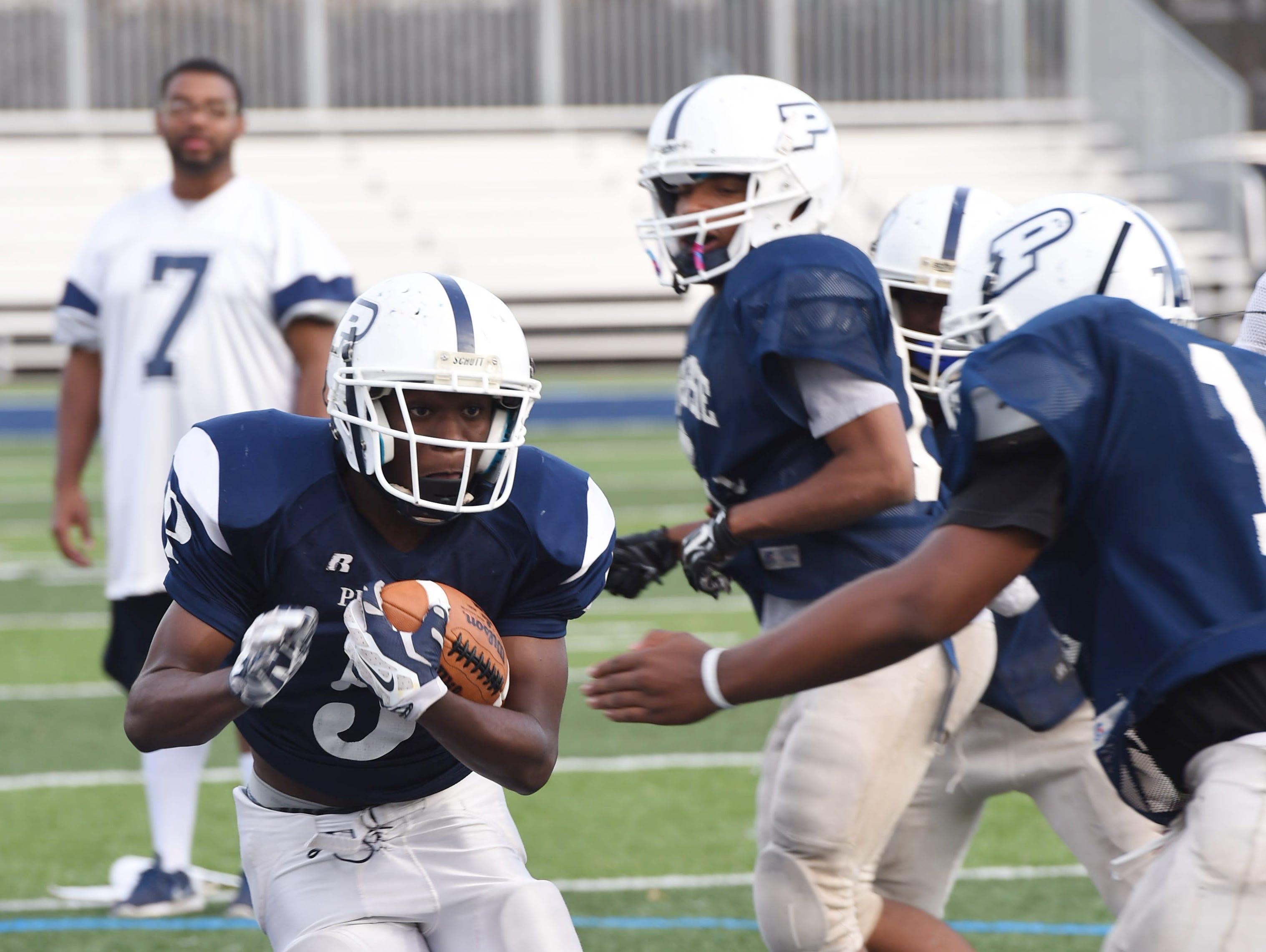 Poughkeepsie's Shaquez Nesbitt runs a play during practice at Poughkeepsie High School on Wednesday.