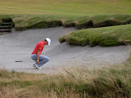 Jordan Spieth reacts to his bunker shot on the ninth hole during the first round of the U.S. Open golf tournament at Chambers Bay on Thursday, June 18, 2015 in University Place, Wash. (AP Photo/Ted S. Warren)