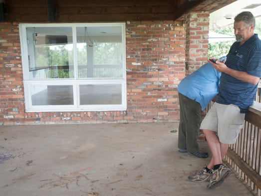 Dan Ramsel stands at his house on Friday, July 24,