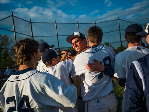 Dallastown's Riley Hamberger, facing, celebrates with