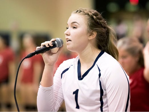 Chambersburg's Meagan Bard (1) sings the National Anthem