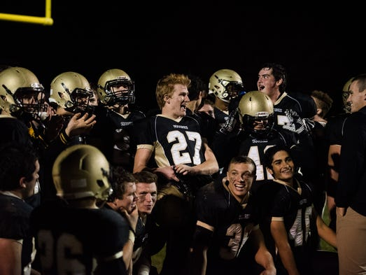 Delone players clamor during a talk after their 45-0