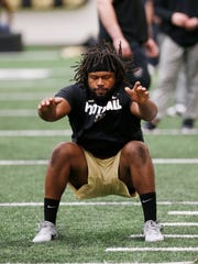 Former Purdue defensive tackle Gelen Robinson with a standing long jump for NFL talent scouts as part of Purdue Pro Day Tuesday, March 6, 2018, inside the Mollenkopf Athletic Center.