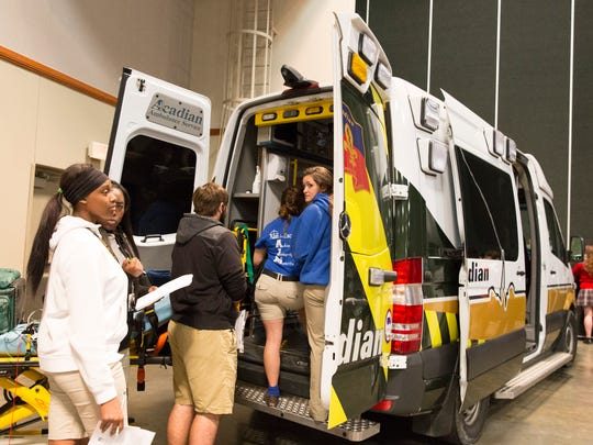 Students look over a an Acadian ambulance at the 17th annual Career Connections Expo  at the Cajundome Convention Center Lafayette on Wednesday. About 4,000 high school students from Lafayette, Iberia, St. Martin and Vermilion parishes discussed career opportunities with business representatives from various fields.