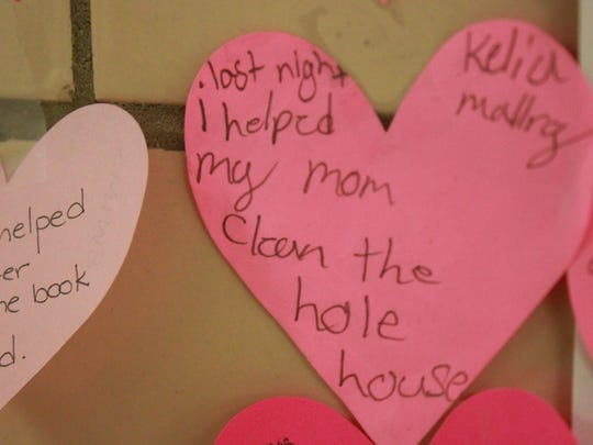 Alexander Elementary School initiated a 'kindness revolution,' with children writing down kind deeds they or others had done and posting them on a wall of 'kind hearts.'