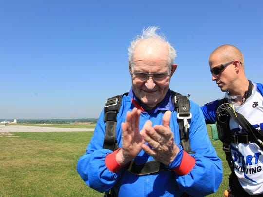After skydiving to celebrate his 90th birthday, John