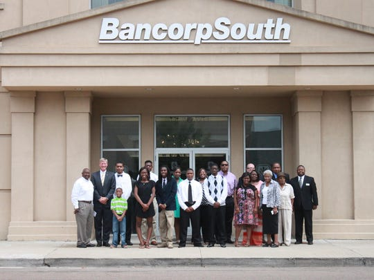 Members of the Follow Me Into Business program, the Jackson-Madison County African American Chamber of Commerce and BancorpSouth pose for a photo Tuesday.