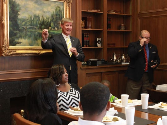 Doug Roth, president of Jackson BancorpSouth, speaks to members of the Follow Me Into Business program Tuesday.