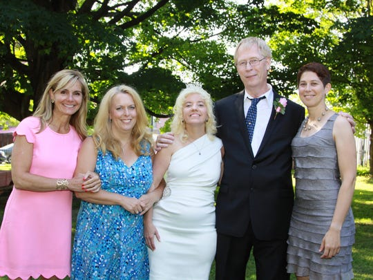 Ronald McDonald House staff members Kristine Bickford, left, Deanna Cameron and Amy Mason, far right, with newlyweds Tina Brigham and Steve Carlsen.