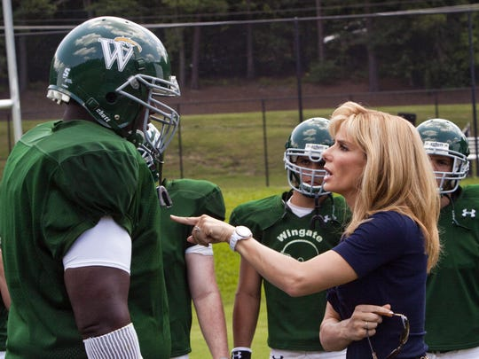 Quinton Aaron as Michael Oher and Sandra Bullock as