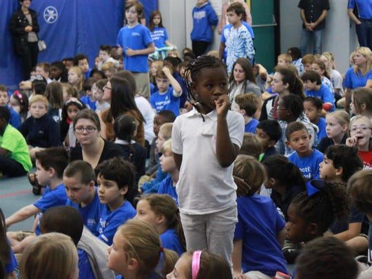 A child stands to be recognized for life skills at Campus School in Memphis.