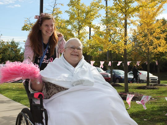 Heartland patient Christina Kabrovich walks with occupational therapist Kate Mercado to raise awareness of breast cancer.