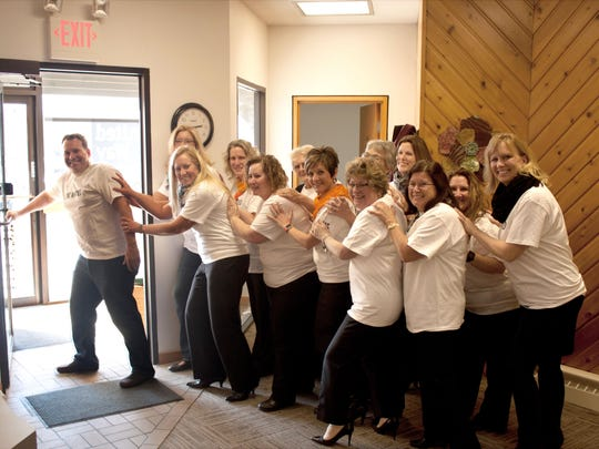 """""""The Power of 12"""" push 2015 campaign chairman Kenlyn Gretz out the door of the United Way Manitowoc County office."""