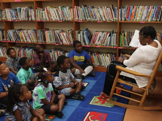 Carolyn Caldwell, incoming principal for Alexander Elementary School, reads to students during the summer Read to be Ready program.