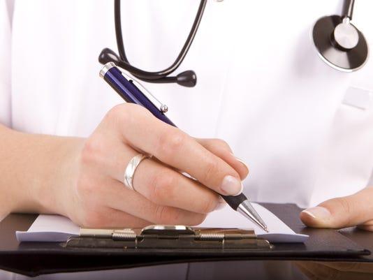 Doctor writing. Digital Hospital