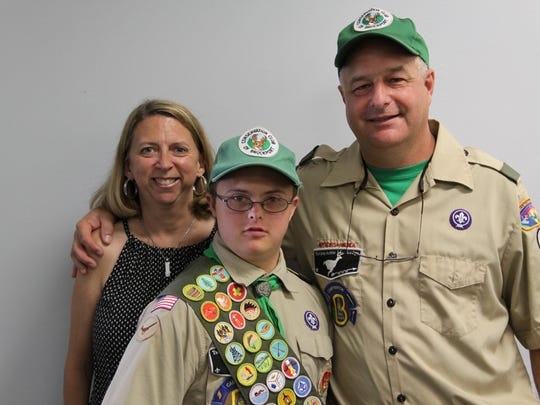 Zachary Adams, 19, of Kendall, with his parents Kelly and Tom at his Eagle Court of Honor ceremony on July 10, 2016, at the Brockport Elks Lodge in Sweden.