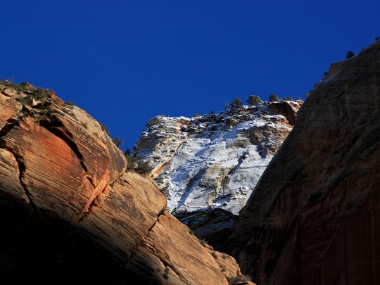 Snow-covered peaks, red rock and deep shadow provide beautiful contrasts during a winter drive through Zion Canyon. Snow fell over much of Utah over the weekend as a cold front swept in and brought freezing temperatures as far south as St. George.