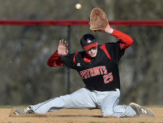 A ground ball takes a last second hop over Penfield