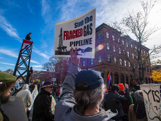 Demonstrators gather outside the building where the