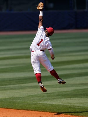 Alabama infielder Cobie Vance jumps catching a pop fly against Florida in the fourth inning during the Southeastern Conference NCAA college baseball tournament at the Hoover Met, Thursday, May 26, 2016, in Hoover, Ala.