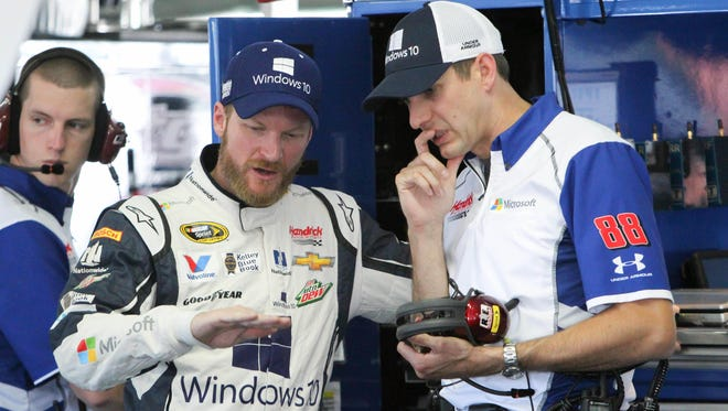 Dale Earnhardt Jr. (left) talks to crew chief Greg Ives during practice Friday at Pocono Raceway.
