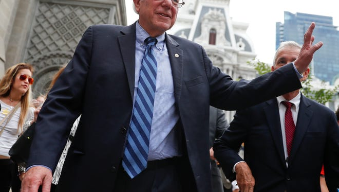 Sen. Bernie Sanders, I-Vt., waves to a supporter in downtown Philadelphia, Thursday, July 28, 2016, during the final day of the Democratic National Convention. (AP Photo/John Minchillo)