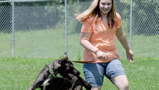 Hope Balliett, 11, walks Dex at the Richland County Dog Shelter.