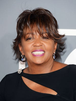 A lawsuit claims that Anita Baker owes more than $39,000 for work done in Grosse Pointe last year.