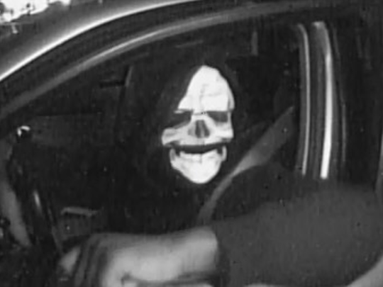 Image of masked person who allegedly took an unspecified amount of money from Globe's bank account.