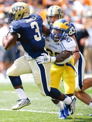 UD linebacker Donte Raymond drags down Pitt running back Chris James on Aug. 30.