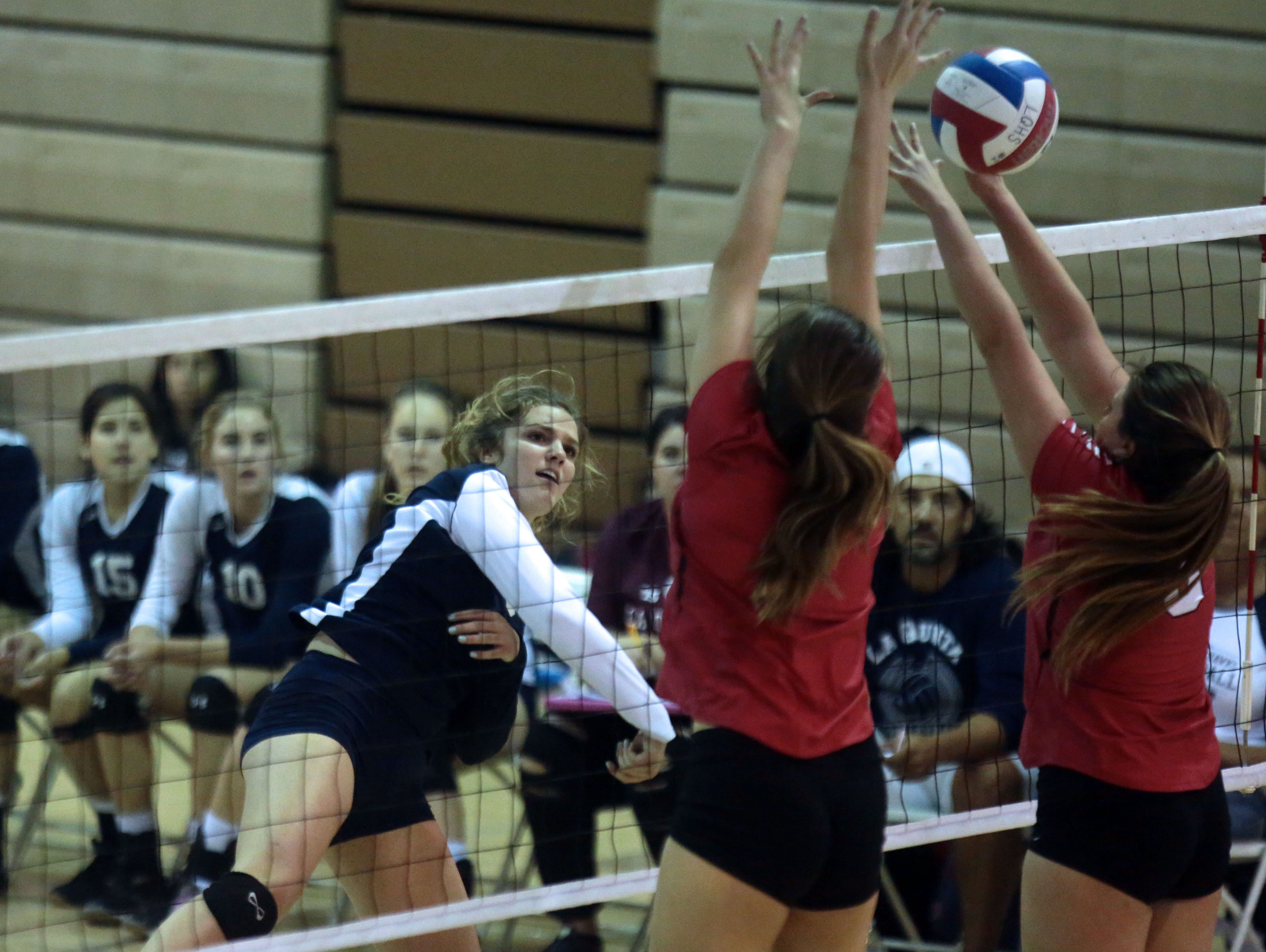 La Quinta's Jolie Samuelson spikes the ball against Palm Springs on Thursday in La Quinta. La Quinta won the match 3 sets to 1.