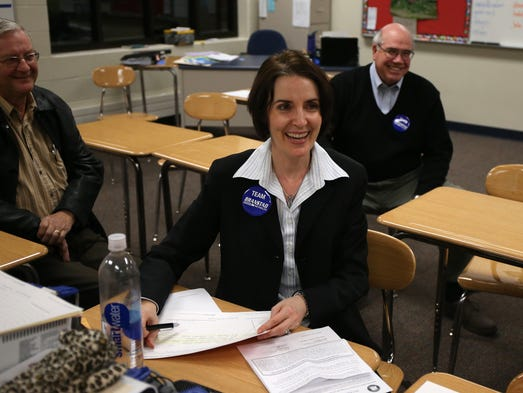 Heather Boustead, secretary of Precinct 5, was one of many caucus-goers to wear Branstad/Reynolds buttons during the Republican mid-term caucuses held at Urbandale High School on Tuesday, Jan., 21, 2014, in Urbandale. (Bryon Houlgrave/The Register)