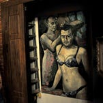 Russian police seize painting of Putin in lingerie