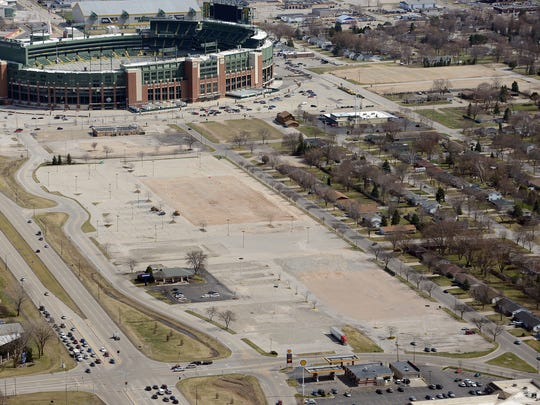 The Green Bay Packers acquired options to purchase more than a dozen duplexes on the south side of Brookwood Lane. They can be seen on the right side of the photo nearest the cleared land.