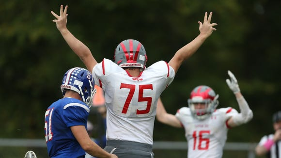 Tappan Zee center Michael Poppe (75) signals touchdown