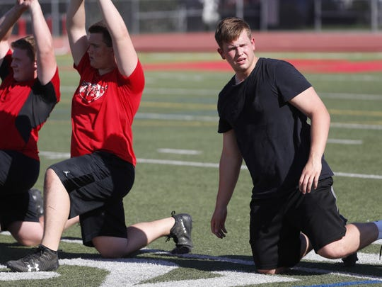 Brophy Prep's Andrew Milek (right) warms up at the team's first spring practice at Brophy Prep's field in Phoenix, Ariz. on April 23, 2018.