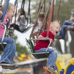Among the family-friendly events this weekend in Southwest Florida is the Southwest Florida & Lee County Fair. In this file photo from 2015, Serenity Dunn, 7, and her brother Phoenix, 4, center, fly on the swings at last year's fair at the Lee Civic Center in North Fort Myers.