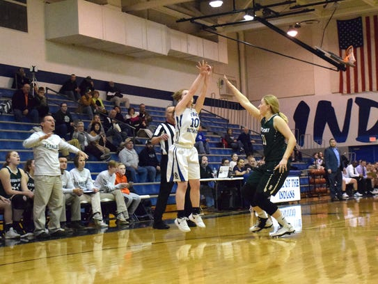 Fort Defiance's Brianna Allen shoots a 3-pointer over