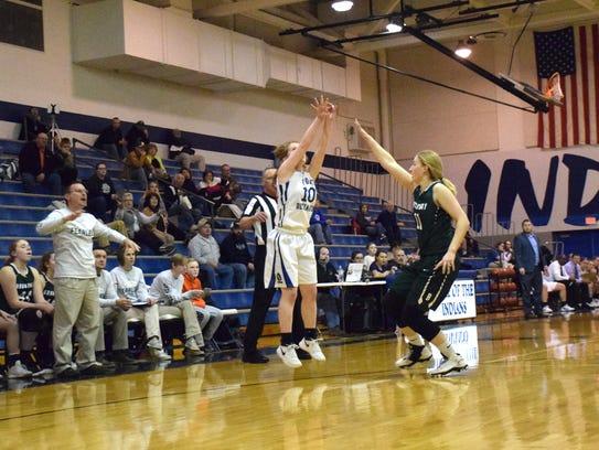 Fort Defiance's Brianna Allen shoots a 3-pointer over