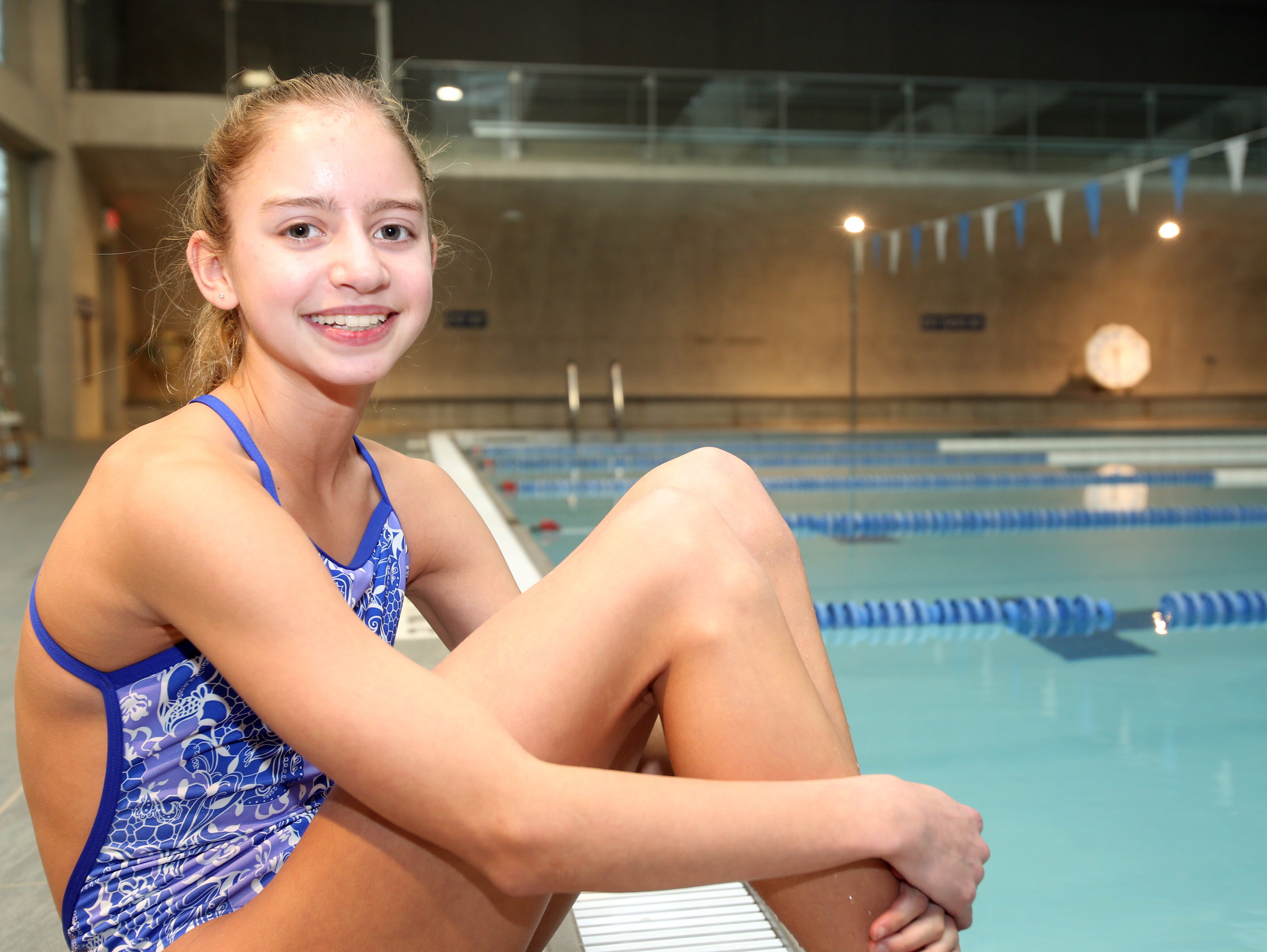 Kate Douglass, a ninth grader at Pelham High School, poses for a photograph before practice at the College of New Rochelle wellness center pool on Dec. 2, 2014. She is The Journal News/lohud Westchester/Putnam Swimmer of the Year for the second consecutive season.