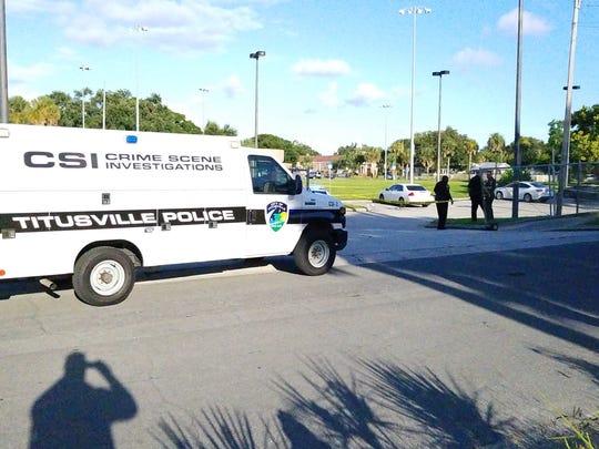 Crime scene investigators are on the scene of a shooting Saturday in Titusville.
