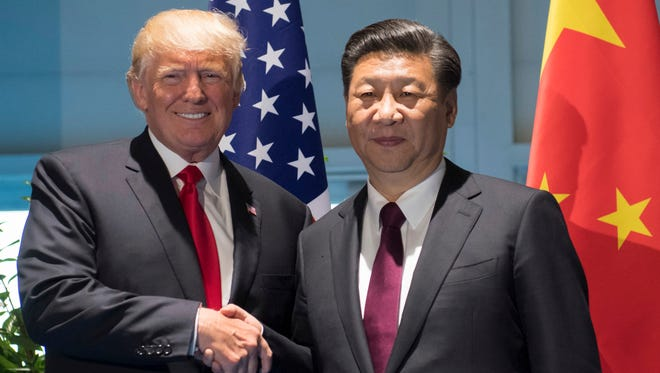 President Trump and Chinese President Xi Jinping shake hands as they arrive for a meeting on the sidelines of the G-20 Summit in Hamburg Saturday.