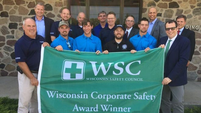 Back row: Chris Halverson, left, Wisconsin Safety Council Advisory Committee Chairman; Ryan Hoernke, FBS Shipyard Finance Director and Acting Planning & Analysis Manager;  Tom Martin, FBS Director of Procurement, Facilities, & Inventory Management;  Stewart Fett, FBS  Production Manager; Tom Carow, FBS Environmental Health & Safety Manager; Thad Birmingham, Mayor of Sturgeon Bay; Chuck Hughley, FMG Vice President of Human Resources; Kurt R. Bauer, President & CEO Wisconsin Manufacturer's & Commerce.  Front row: Todd Thayse, left, FBS Vice President & General Manager; Ricky Sternard, Local 1521 Carpenter's Industrial Council; Andrew Huston, UA Local 400; James Majestic, IBEW Local 158; Matt Malvitz, Local 449 Boilermakers; James Majestic, IBEW Local 158 ; Francesco Valente, FMG President and CEO.
