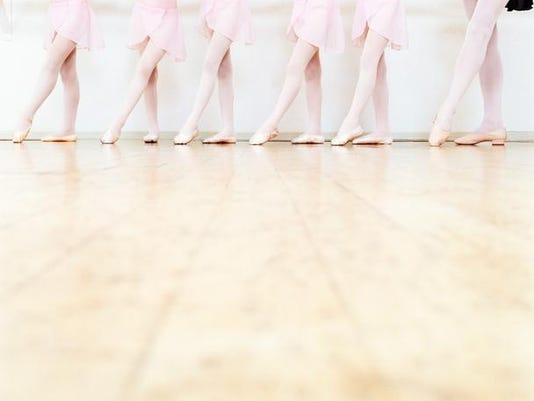 Low Section View of a Line of Young Ballet Dancers Practicing in a Dance Studio