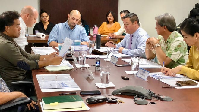 Guam Economic Development Authority Board Chairman E.J. Calvo, center, leads a regular board meeting Monday, March 26, in which GEDA's qualifying certificate program was discussed, including that of the Guam Regional Medical City.