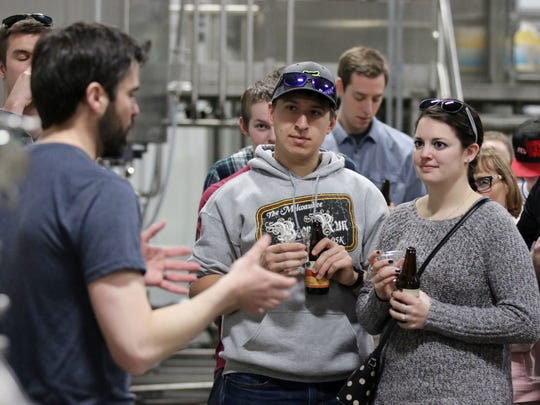 3 Sheeps Brewing's Grant Pauly, left, explains the brewing process while Alex Yosick, center, and Jackie Burtka, right, both of Howards Grove, listen during a tour of the brew house             Saturday April 8, 2017 in Sheboygan.