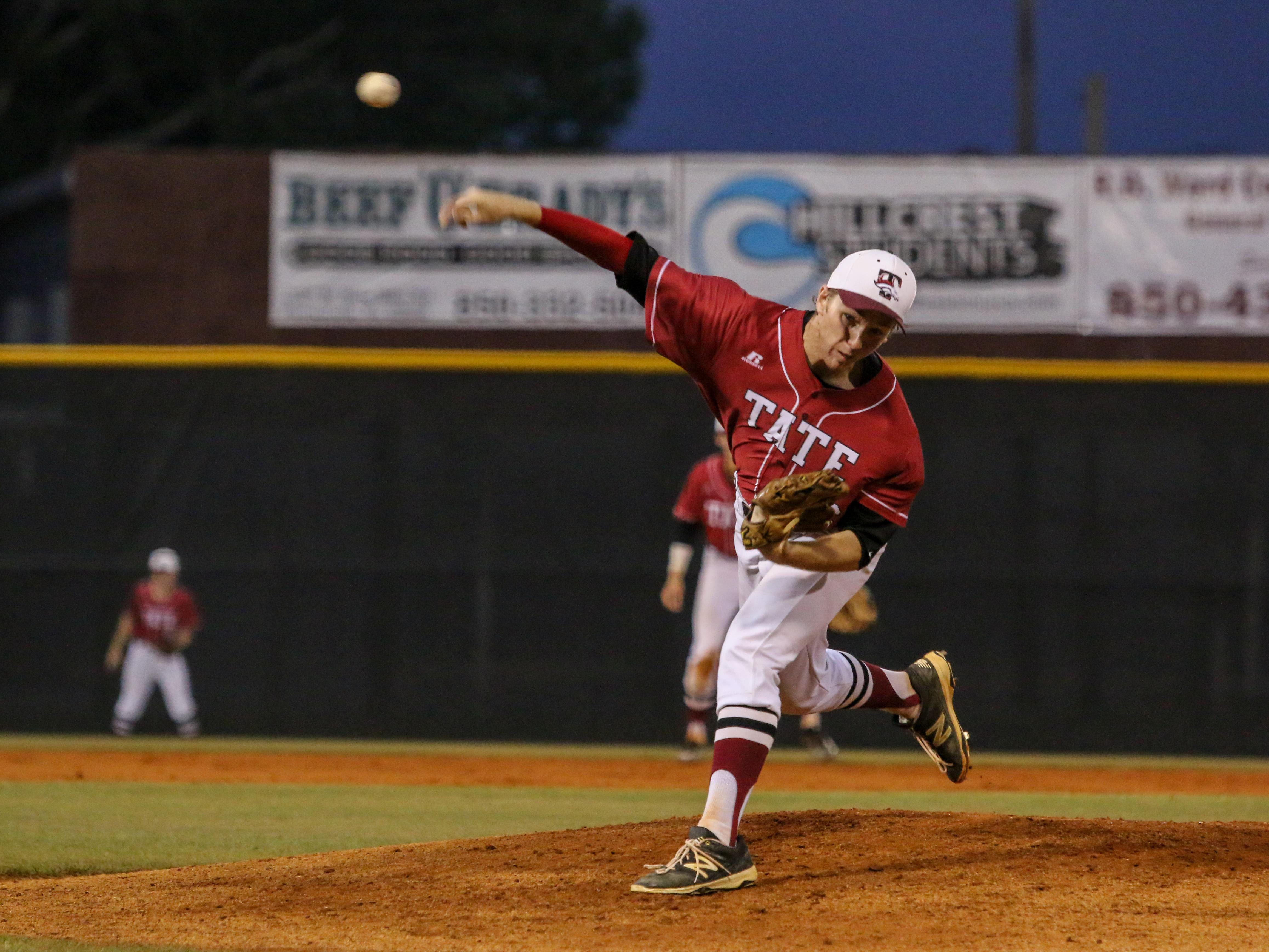 Tate's Jake Davis pitches against Navarre Wednesday night during the Region 7A quarterfinal game at Tate High School.
