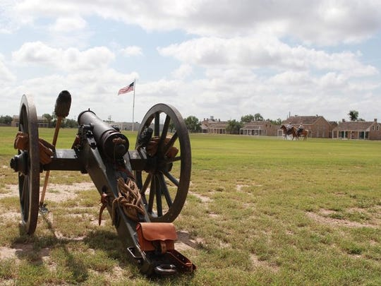 A cannon is set up for artillery salutes to celebrate the Fourth of July on the parade grounds at Fort Concho.