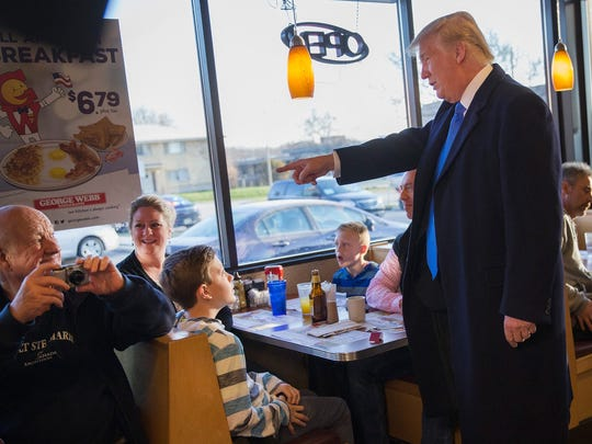 Donald Trump chats with patrons and workers at a diner