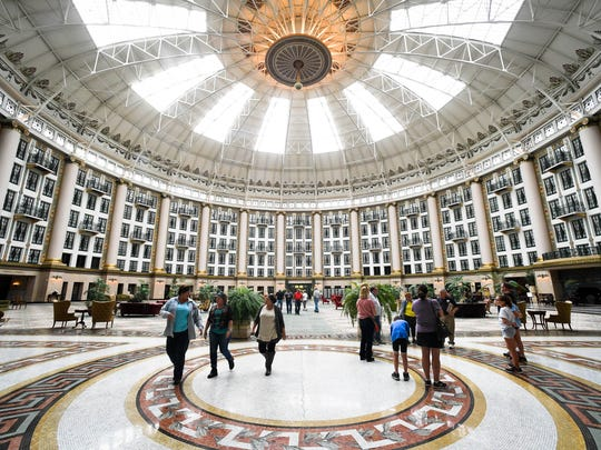 Visitors and guest enjoy the view of the massive atrium in the West Baden Springs Hotel Sunday. The hotel, built in 1902, was restored and opened in 2007, 75 years after serving as a hotel, October 30, 2016.